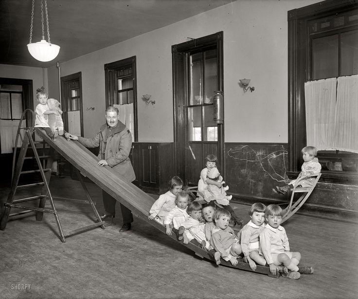 "Washington, D.C., circa 1921. ""Foundling Hospital, playroom."" Tots at the Washington Asylum for Foundlings, 1715 15th Street N.W., with their benefactor Lt. George Pickett 3rd."
