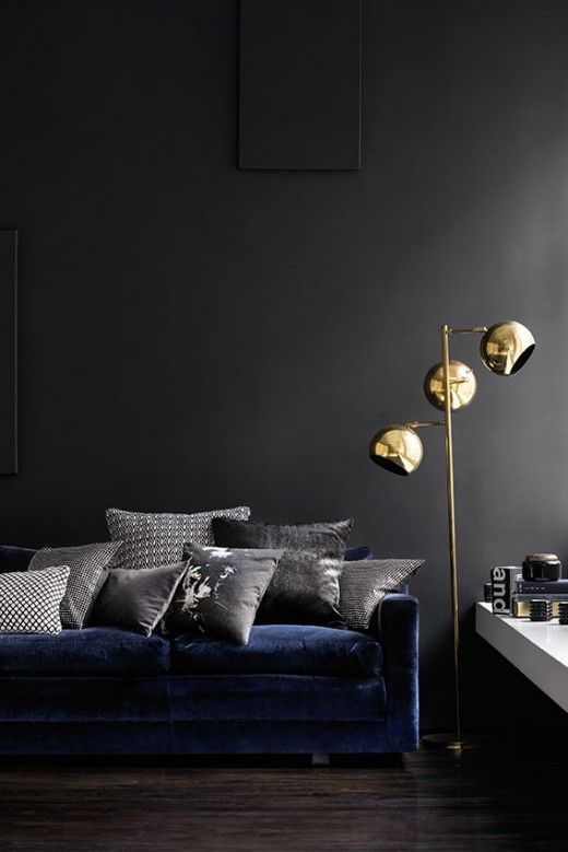 Interior shot from the new H & M Home range, slate wall with blue velvet sofa