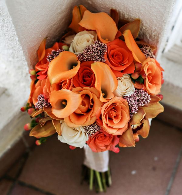 Tangerine and Blood orange rose bouquet… Photographer: Keith Cephus Photographer… floristhttp://www.weddingwire.com/biz/mossaico-inc-san-juan/120886462118ee0e.html