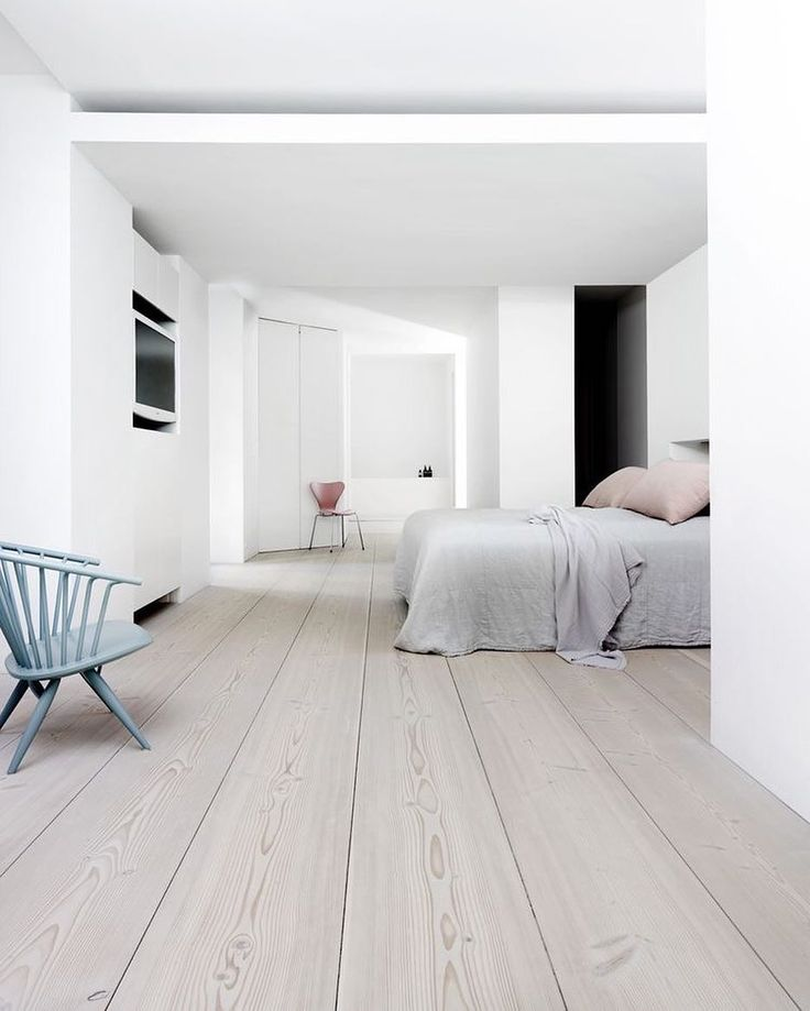 Light wood floor, minimalist decor, mostly white interior