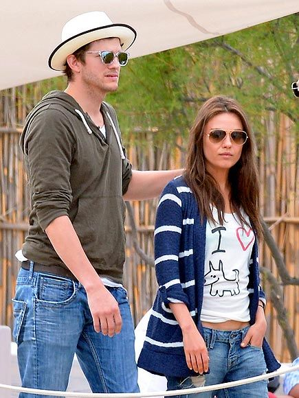 Ashton & Mila cozy up in their shades as they take a stroll in St. Tropez. Absolutely loving his crystal frames!