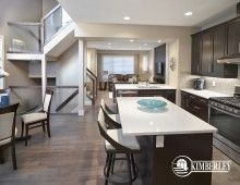 Kitchen, with eat-up island and peninsula. Quartz counters, stainless steel appliances. Open-to-above dining nook. Luxury 3 bedroom townhomes. The Intrigue model, by Kimberley Communities.