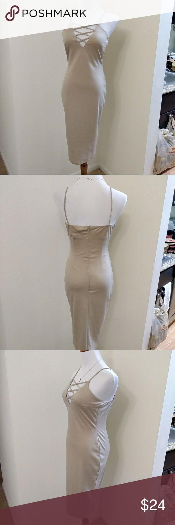 Nude beige lace up cage front bodycon dress 😍😍😍 SUPER sexy nude tan neutral cage front lace up dress. This beige baby is made out of stretchy, curve hugging body con material and oh so fab. It has a zipper from lower back to top on the backside and spaghetti straps. From Charlotte Russe and tagged a size small - in my opinion could fit an extra small to a medium. This dress is perfect for going out with no bra. Very stretchy but not thin. Holds up the girls great! 😉 Message me for…