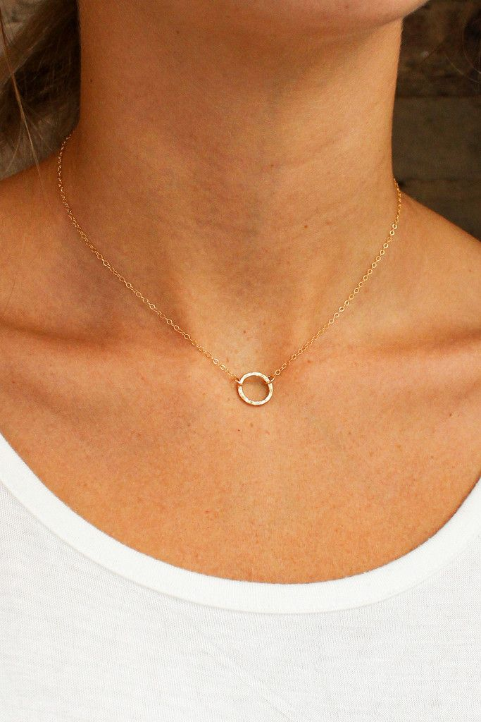 A simple, hammered closed ring signifies friendship, eternity and love. This minimalistic necklace is the perfect gift for anyone! - Closure: Lobster clasp. - Materials: 14k Gold Filled - Measures 15""