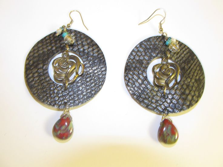 Handmade leather earrings (1 pair)  Made with black/silver leather, metal flower, glass beads and semiprecious stones.
