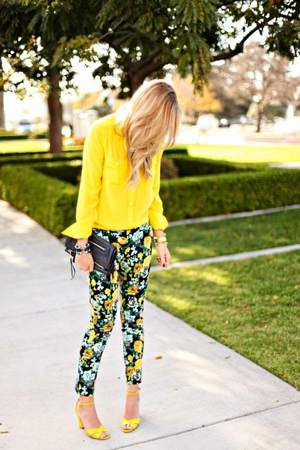 Florals and bright yellow dress with yellow heels and black purse