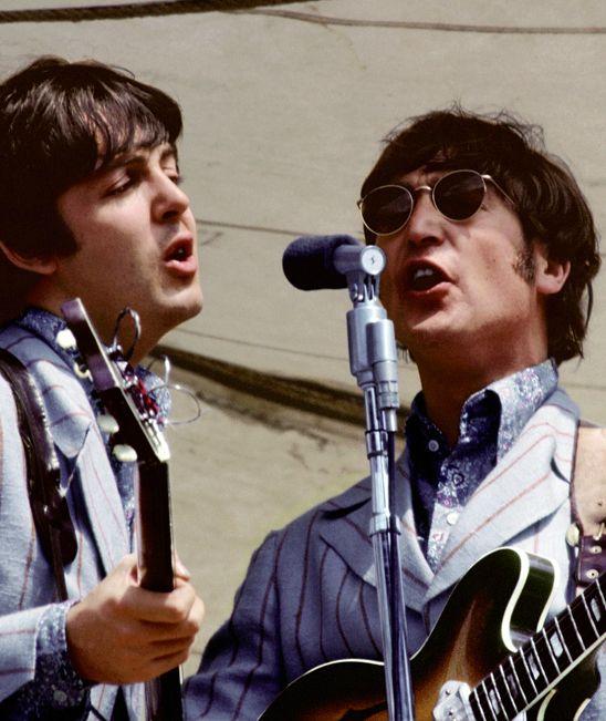 The Beatles: Paul McCartney and John Lennon on stage.