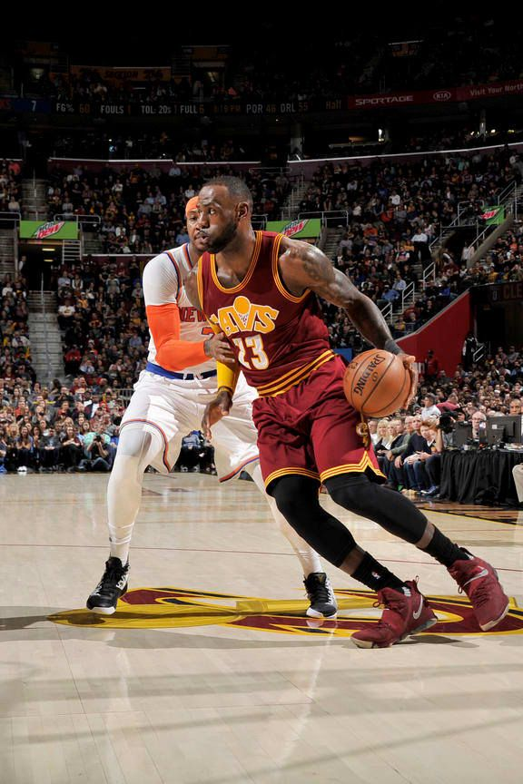 LeBron James #23 of the Cleveland Cavaliers handles the ball against Carmelo Anthony if the New York Knicks on February 23, 2017 at Quicken Loans Arena in Cleveland, Ohio.  Cavs won 104 to 119 and LeBron finished with a triple double - 18 points, 13 rebounds and 15 assists!!!