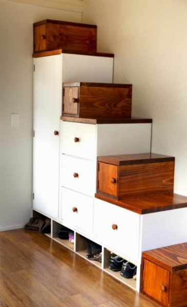 The storage stairs inside a tiny house with dimensions(in millimeters) and a formula for figuring out your own stairs.