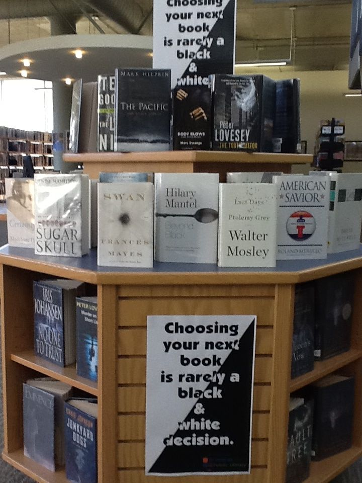 Choosing your next book is rarely a black and white decision. St. Thomas Public Library - October 2013