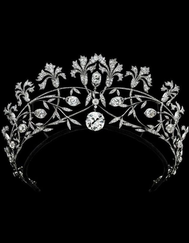 A diamond tiara by Chaumet, 1905, a floral piece featuring Pinks, with large diamond buds and an even larger circular diamond at it's centre.