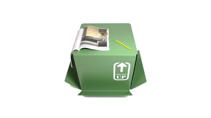 """The """"this side up"""" table looks like a carton box and in some ways it is as useful as a carton box!"""