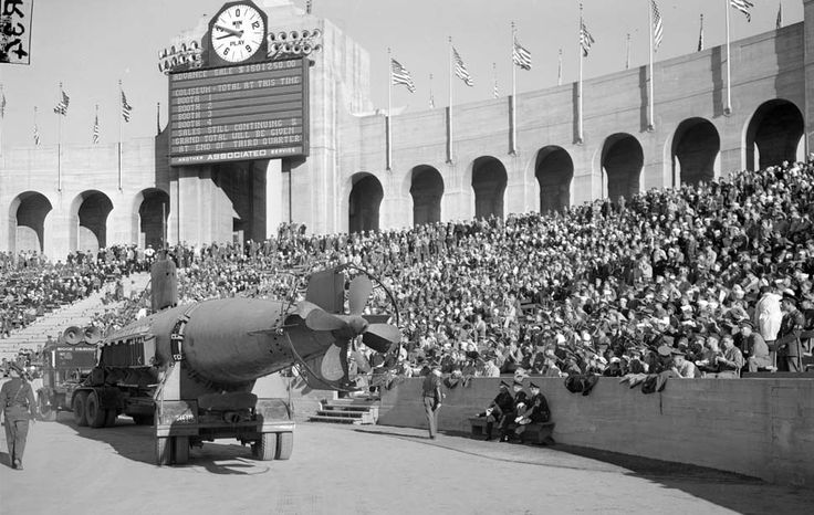 Dec. 12, 1942: Captured Japanese midget submarine is paraded around the Los Angeles Memorial Coliseum during USC-UCLA football game. The sub had participated on the attack on Pearl Harbor.