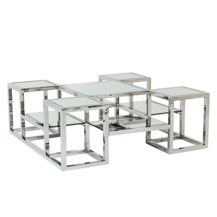 Ett spännande fykantigt soffbord i flera etage. Bordet har ett stramt underrede i blankpolerat stål och bordskivor i spegelglas.