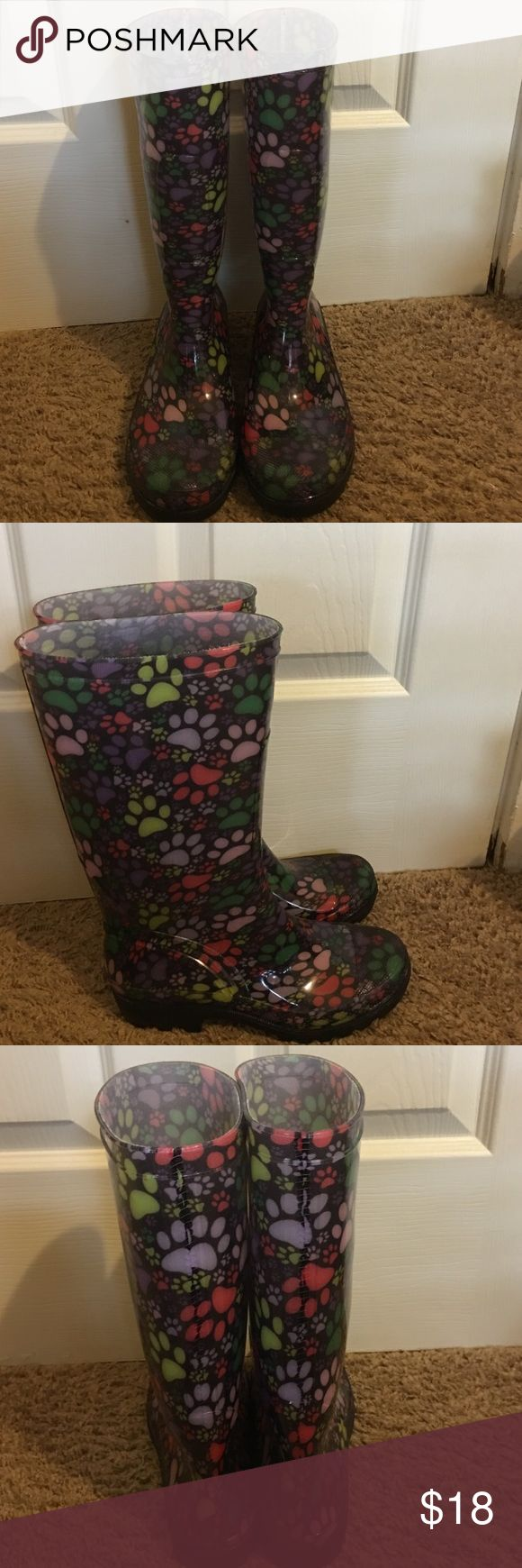 Paw print wellies I received these when I donated to an animal shelter. They are too cute. It says they're a size 8, but I wear a size 7 and they fit fine. Worn twice. All rubber. Fits a smaller calf. Shoes Winter & Rain Boots