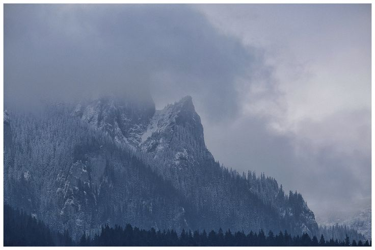 In the clouds ... - White mountain peaks in the clouds in winter season.