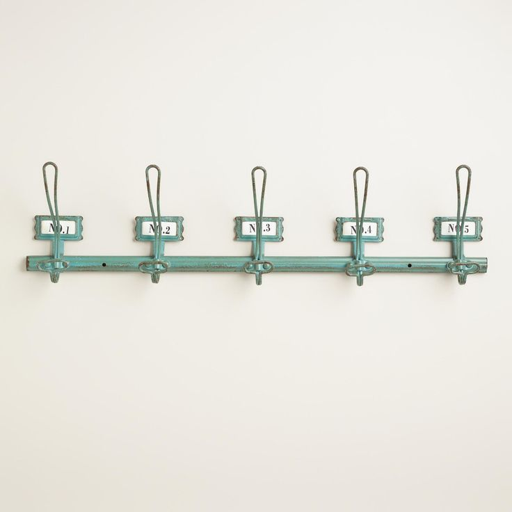 A perfect place to corral wayward scarves or shopping bags, our distressed aqua wall rack features five hooks for hanging and numbered paper inserts that can be removed to make way for personalized labels. >> #WorldMarket Laundry Shop