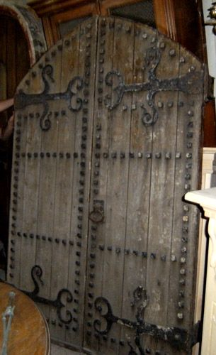 Salvaged English Castle doors waiting to be used in new home.  OMG this would be my dream door!  *swoon*