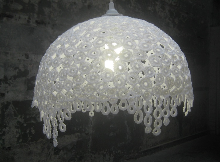 Crochet pendant light, made from cotton circles joined together then placed in stiffening liquid and shaped around a mould.