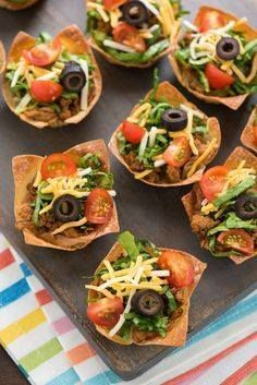 Mini Turkey Taco Sal Mini Turkey Taco Salads - An...  Mini Turkey Taco Sal Mini Turkey Taco Salads - An appetizer-sized version of the restaurant classic! Layers of beans seasoned ground turkey cheese lettuce and tomato inside of wonton wrapper taco shell bowls! | foxeslovelemons.com Recipe : http://ift.tt/1hGiZgA And @ItsNutella  http://ift.tt/2v8iUYW