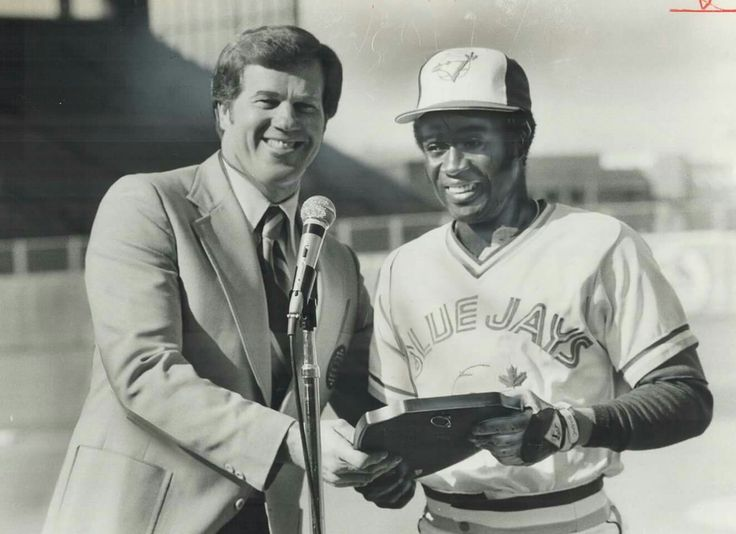 Two winners: Television commentator Tony Kubek presents American League 1979 rookie-of-year award to Jays' shortstop Alfredo Griffin prior to yesterday's game at Exhibition Stadium. Griffin shared award with John Castino of Minnesota. Kubek won the award in 1957 - Courtesy of Toronto Public Library & the Toronto Star Archives
