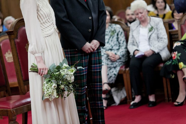 Wedding ceremony at Islington Town Hall. Love the bride's wedding bouquet and the groom's scottish theme trousers.