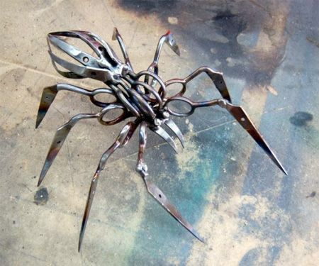 Spider sculptures made from scissors. Cool. Looks right out of Transformers.