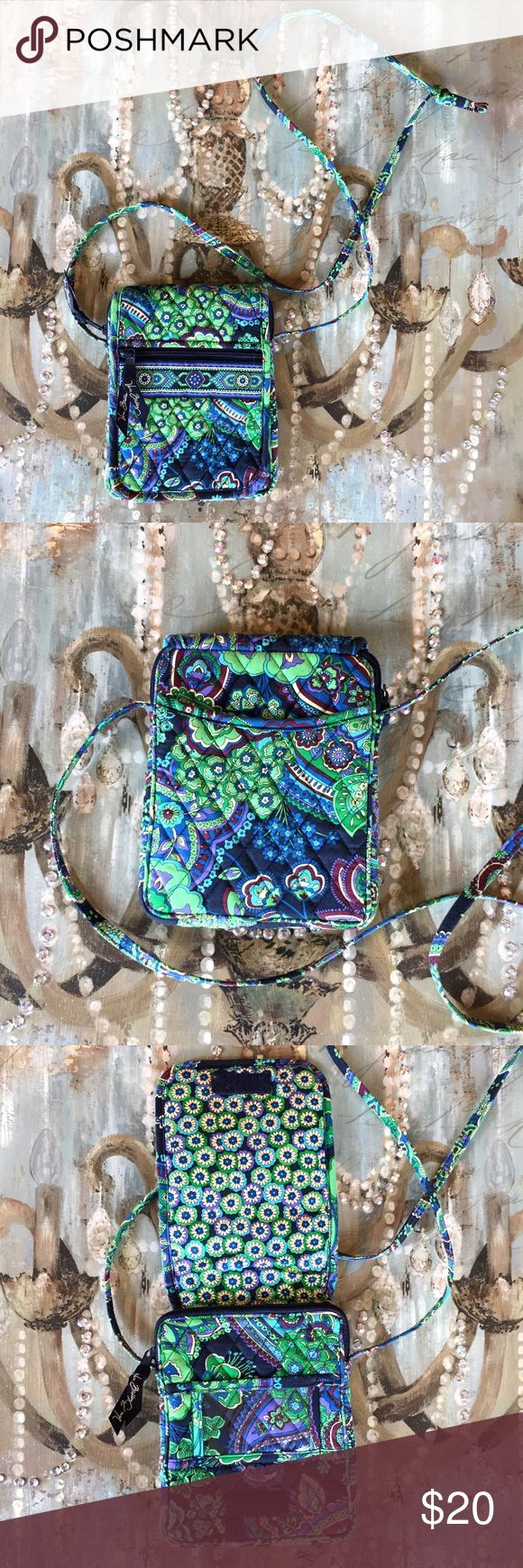 Vera Bradley Purse This Vera Bradley purse has many compartments on it and inside of it! It has NEVER been used and is in PRISTINE condition! :) Vera Bradley Bags Crossbody Bags