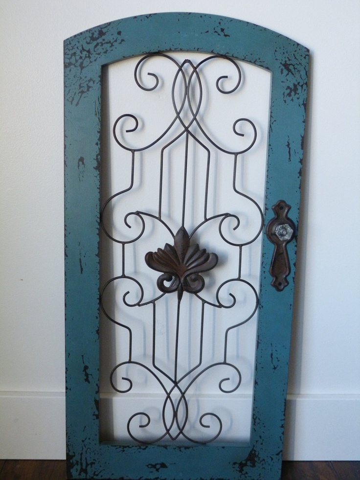 Rustic / Turquoise Blue / Cottage Chic / Iron Wall Decor / Wall Hanging / Shabby and Chic / Patio Decor. $49.99, via Etsy.