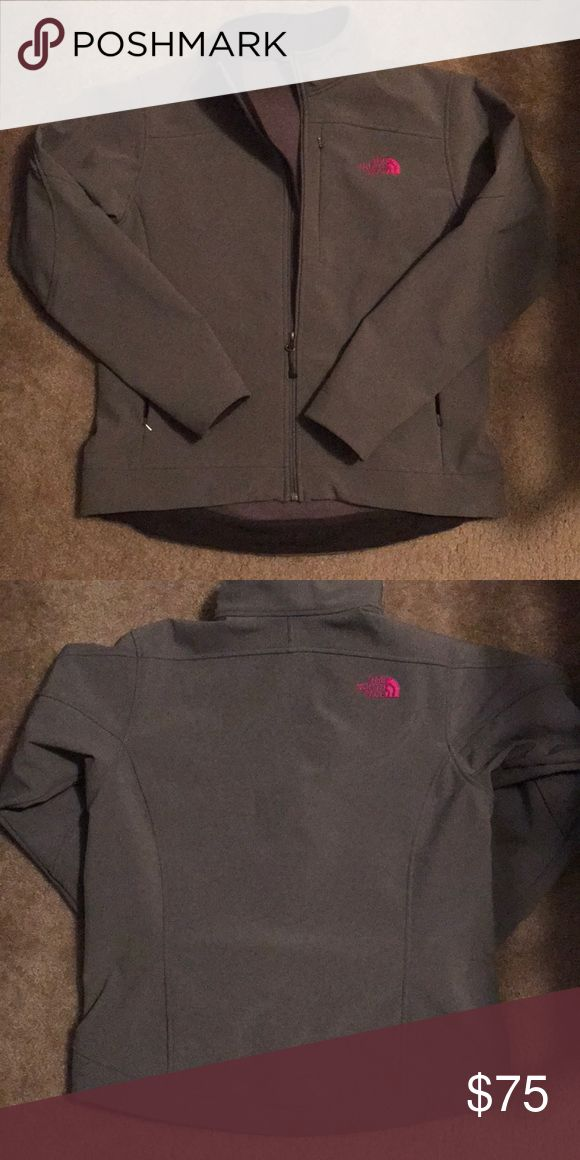 Women's Large North Face Apex Jacket Durable wind-resistant jacket with a fleece lined inside. Jacket was well taken care of. Dark grey exterior with pink lettering. The North Face Jackets & Coats