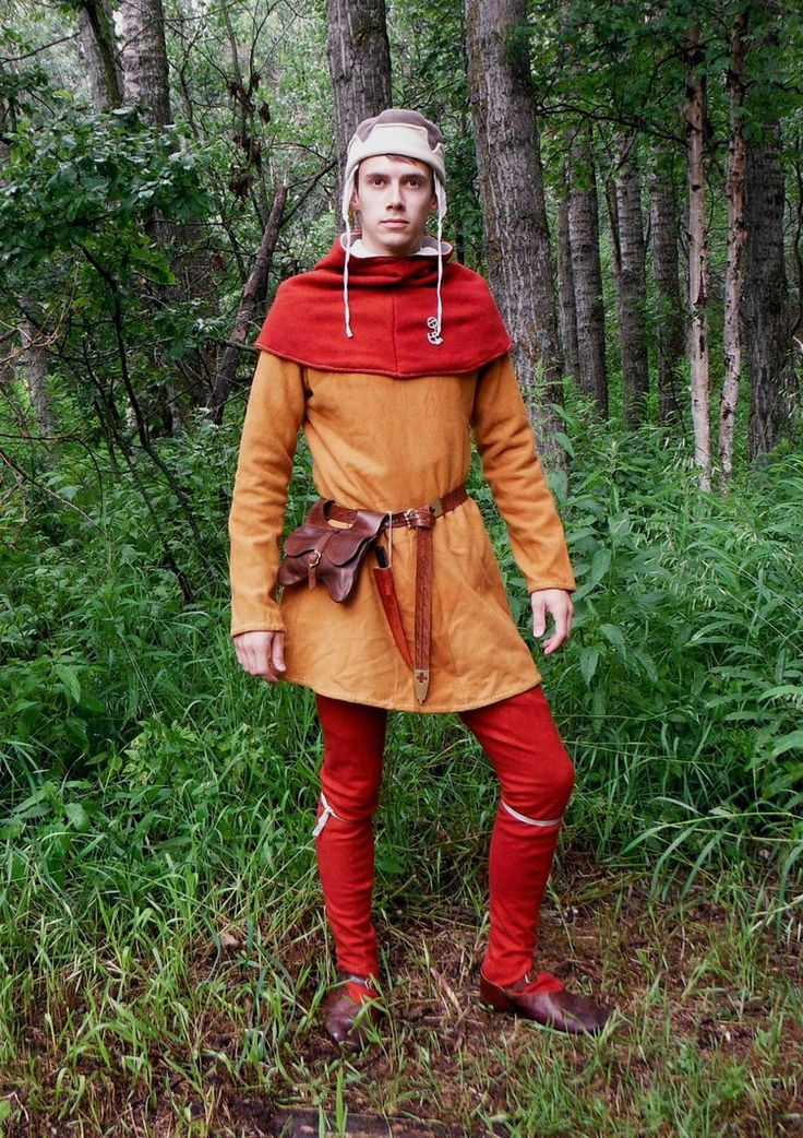 """ew 14th century civilian men's clothing, entirely hand sewn with linen thread. Chausses, tunic, hood, and hat made of wool. Tunic dyed with onion skins, chausses and hood dyed with madder root. The tunic is based on the 14th century """"Bocksten Man"""" tunic from Sweden, the hat is loosely based on one in the Luttrell Psalter. New pouch made of vegetable tanned cowhide based on those in """"Purses in Pieces"""" by Olaf Goubitz."""