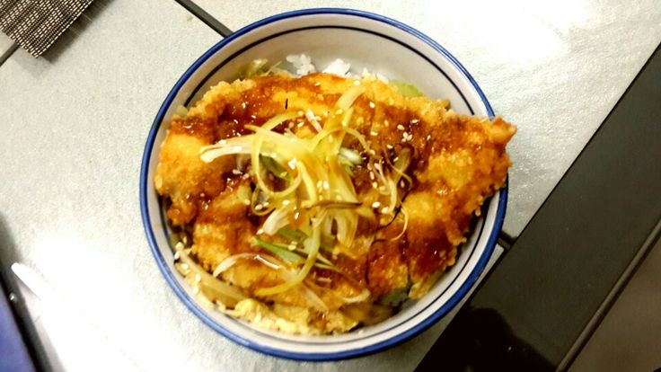 Katsudon Chicken katsu donburi serve with pouched egg , teriyaki sauce and slices grilled onion
