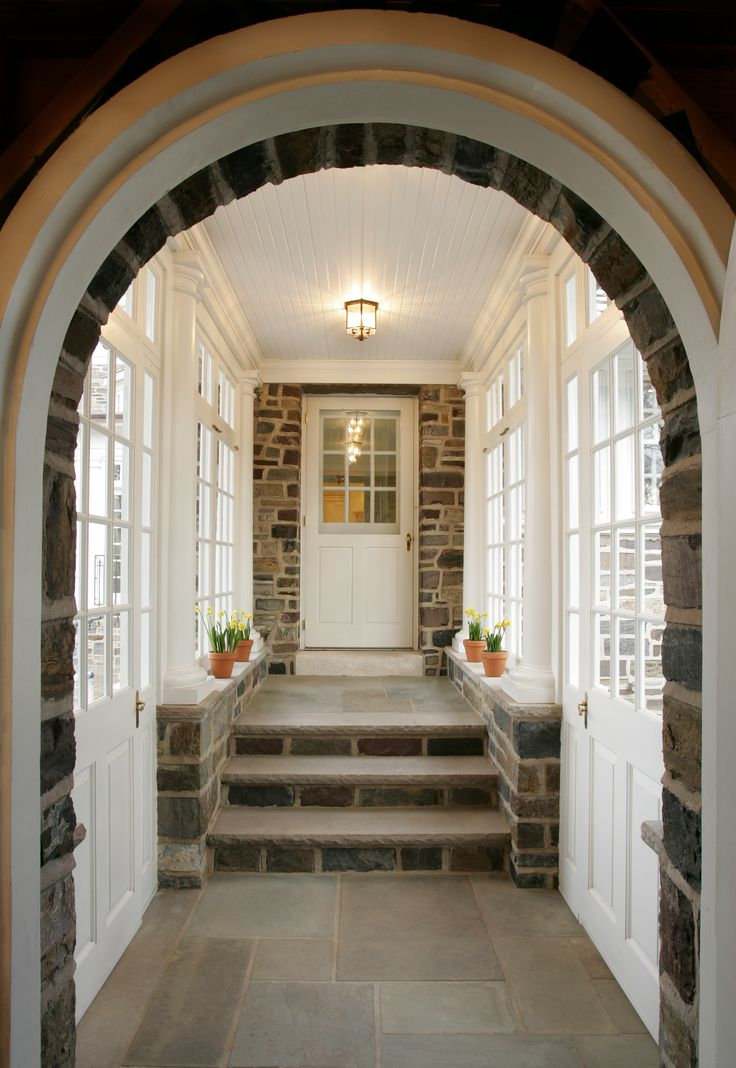 The garage is connected to this stately home by an enclosed glass and stone  breezeway.