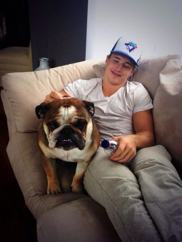 Cutest picture in the world. Brendan with Josh Gorges' dog :) make me smilin'!!!