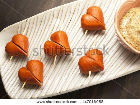 Cute appetizers. Sausages with mustard. by Carla Nichiata, via Shutterstock
