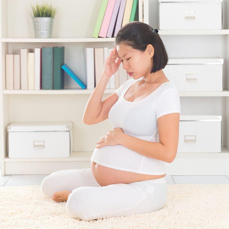 Pregnant woman having headache