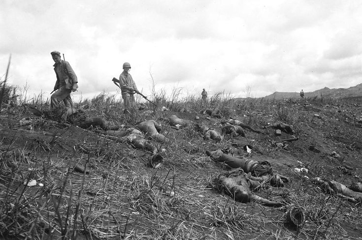 The bodies of Japanese soldiers lie strewn across a hillside after being shot by U.S. soldiers as they attempted a banzai charge over a ridge in Guam, 1944.