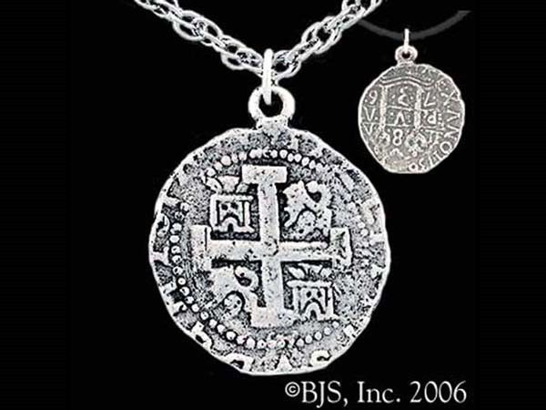 The three-dimensional Pieces of Eight Necklace is available in sterling silver.  The pirate coin pendant is an authentic replica of a Spanish Pillars and Waves Pieces of Eight coin.