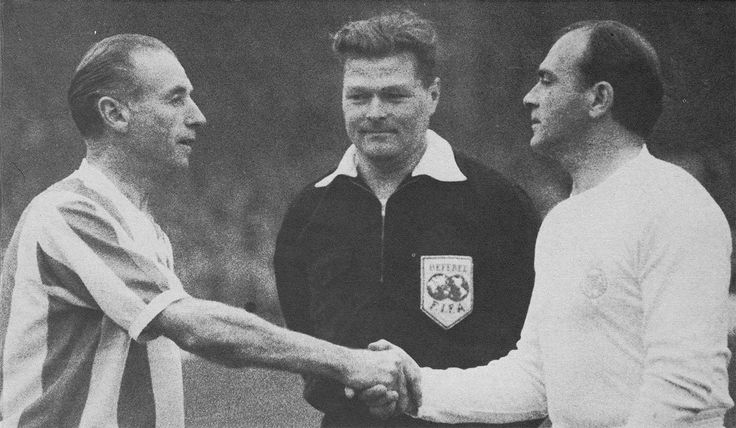 24th April 1963. Stoke City legend Stanley Matthews shaking hands with Real Madrid forward Alfredo Di Stefano during a friendly to celebrate promotion to the top flight, at the Victoria Ground.