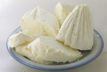 white cottage cheese image by Maria Brzostowska from Fotolia.com