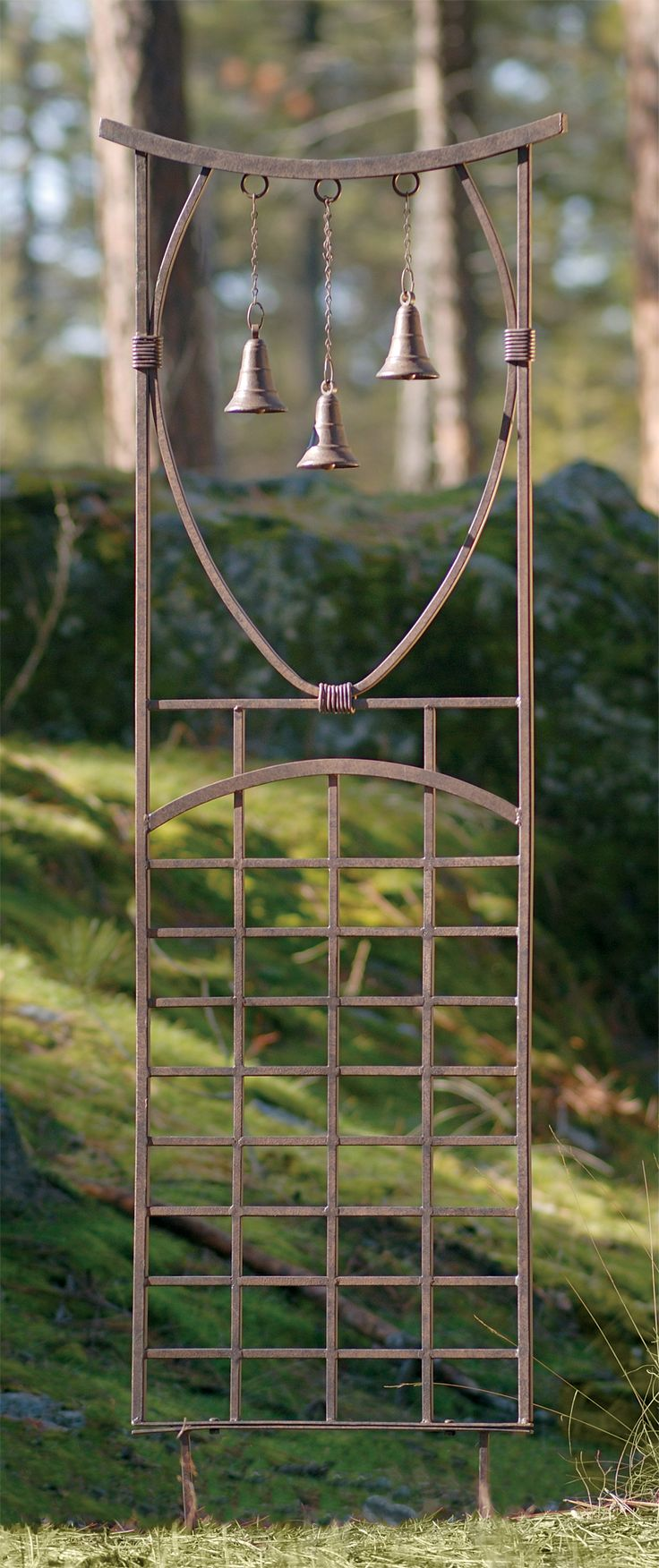 Witch Garden:  #Witch #Garden ~ This #trellis has wind chimes. They'd also be a great alarm when you're busy in the garden and someone comes to visit!