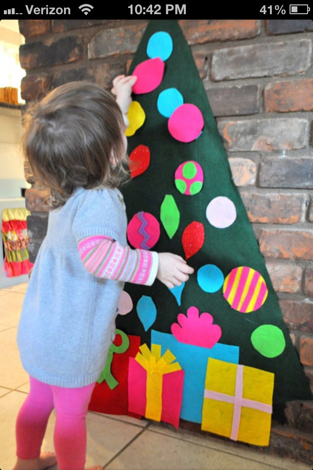 Toddler friendly Christmas tree. Great idea to have their own to play with.