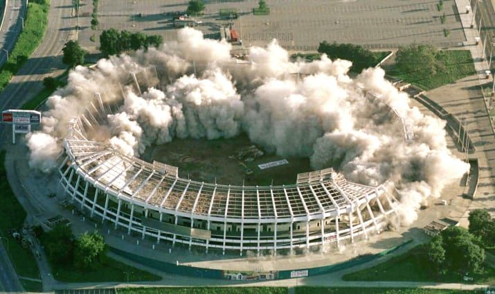 The Atlanta-Fulton County Stadium, used as a Centennial Olympic baseball venue in Atlanta, Georgia, begins to fall after 350 pounds of explosives detonate in 1997.