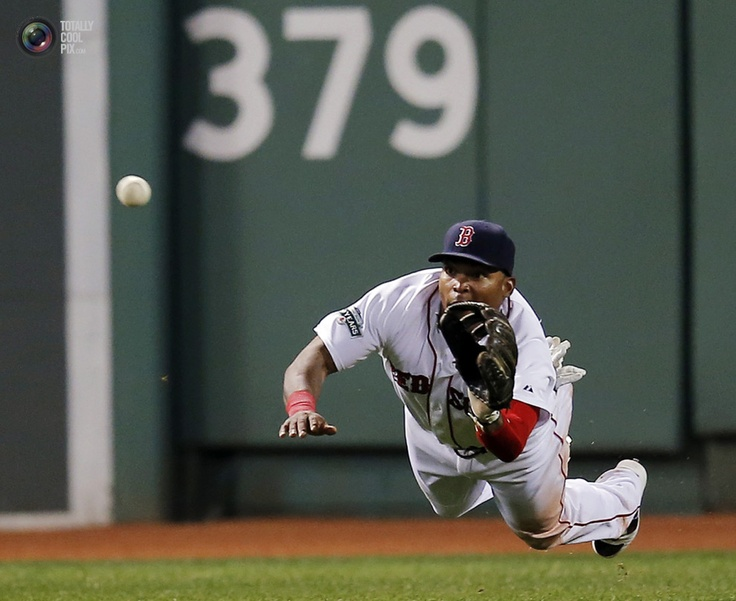 Boston Red Sox's Byrd makes a diving catch on a ball hit by Detroit Tigers' Laird during their MLB American League baseball game in Boston. BRIAN SNYDER/REUTERS