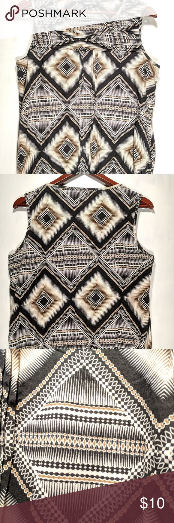 """Geometric sleeveless tank top Excellent condition, looks like it has never been worn. No signs of wear, stains or damage.  Cute geometric design with pleats for added style, and cinched in lower hem.   Please note this is a UK size 10, roughly equivalent to a U.S. Size 6/Small. Please review the measurements below to ensure this will fit you as desired. Arm pit to arm pit =19.5"""". Mid shoulder to lower hem = 24"""". Across lower hem = 14"""" with easily another 8"""" in stretch. debenhams collection…"""