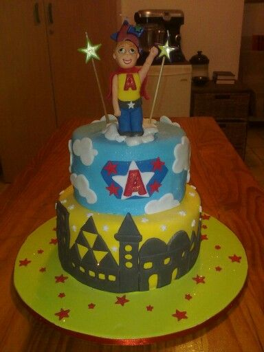 Superhero cake with cityscape and blue sky. www.koekeloercakes.co.za