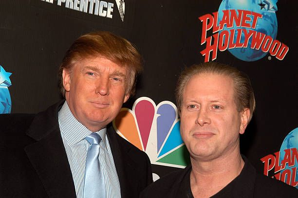 Donald Trump left and SNL comedian Darrell Hammond arrive at 'The Apprentice' viewing party on January 29 2004 at Planet Hollywood in New York City