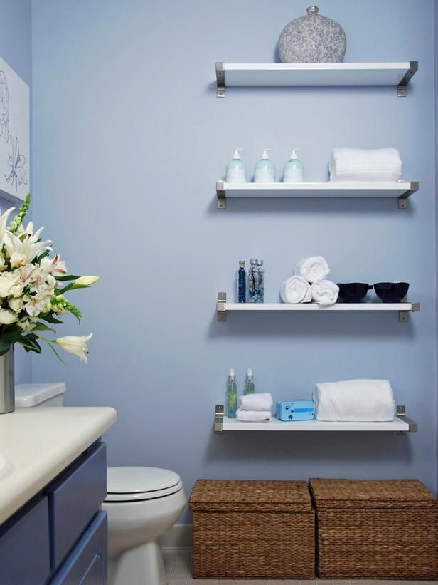 Small Bathroom Storage Solutions: Fill open wall space with floating shelves.  They're readily available at big retailers, inexpensive and easy to install.    From DIYnetwork.com