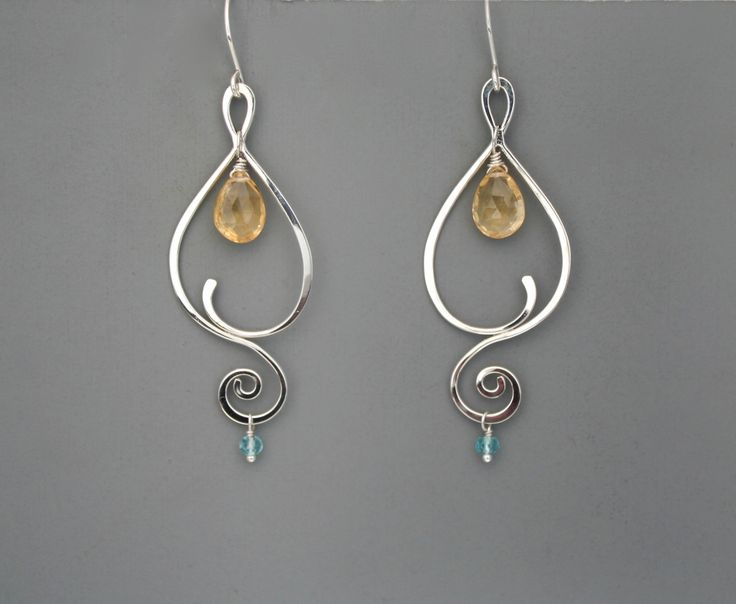 These earrings are handmade from sterling silver. I create them starting with straight wire which I shape, solder, hammer and finally give a beautiful shiny finish. Available in several gemstone combinations with one larger stone in the center and a small one dangling from the bottom. They are very comfortable to wear and measure 2 1/4 long including the ear wire. Please let me know in the note to seller witch colors you would like. Rachel Wilder Jewelry is all handmade solely by the…