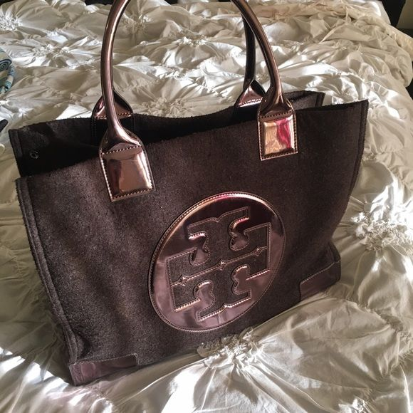Authentic brown tote large Flannel material.bag is great condition except for little wear around the handle. See pic FREE spade bracelet with the purchase. Bracelet pic is my closet listing Tory Burch Bags Totes